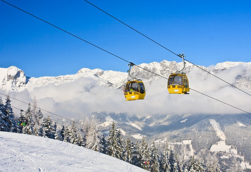 Yellow cable cars in the mountains witch snow